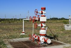 Well for oil and gas production. Oil well wellhead equipment. Oil production Stock Photography