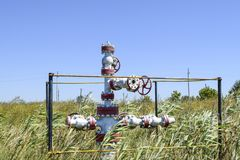 Well for oil and gas production. Oil well wellhead equipment. Oil production Royalty Free Stock Images