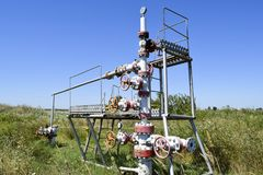Well for oil and gas production. Oil well wellhead equipment. Oil production Stock Photos