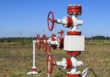 Well for oil and gas production. Oil well wellhead equipment. Oil production Royalty Free Stock Photo