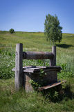 Well. The old well in the meadow Stock Images