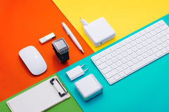 Well organised white office objects on colorful background Royalty Free Stock Images