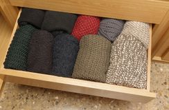 A well-organized drawer, top view. A well-organized closet drawer. neatly stacked in piles. Storage system. Wardrobe order stock photos