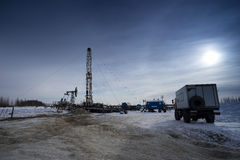 Well pad. Winter landscape with oil derrick stock image
