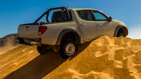 Well parked. Vehicle trapped on top of a dune Royalty Free Stock Photos