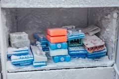 Well plate with test tubes with frozen DNA samples for PCR-reaction analysis in the fridge.  stock photography