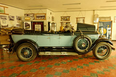 A well-preserved antique car in an old classic showroom Stock Image