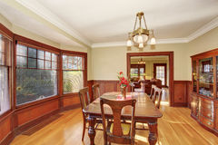 Well put together dinning room with hardwood floor. Well lit, and put together dinning room with dark wood dinning set Royalty Free Stock Photo