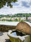 Well and riverside in Passau Stock Photo