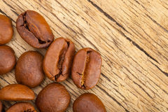 Well roasted coffee beans over old table Royalty Free Stock Photo