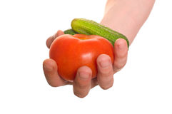 Well shaped hand with fresh vegetables Stock Images