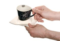 Well shaped hands with a coffee cup Stock Photo