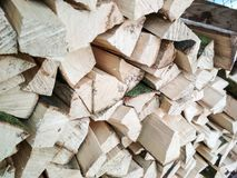 Well stacked wood in a woodhouse. Artistic photo of fresh and jung wood stacked a woodhouse. Beauty of nature Royalty Free Stock Photos