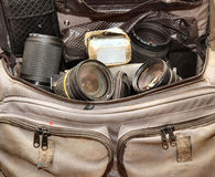 Well stocked camera bag. Shot of well stocked camera bag, with lenses, strobe done with bounce and fill Royalty Free Stock Photography
