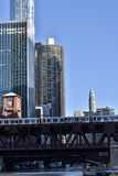 Well Street Bridge. This is a Winter picture of the Wells Street Bridge over a Freezing Chicago River with iconic Chicago building in the background.  The bridge Royalty Free Stock Photo