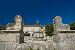Well in Svetvincenat. Stonemade well on the square in Svetvincenat on a sunny day Royalty Free Stock Photo