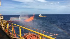 Well testing operation flaring on offshore drilling rig. Well testing operation flaring on offshore semi-submersible drilling rig. Supply boat on stand by in the stock video footage