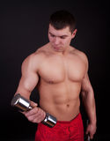 Well-trained man in gym Royalty Free Stock Photo