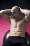 Well trained man in gym Royalty Free Stock Photography