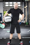 Well trained man with med-ball at the gym Royalty Free Stock Photo
