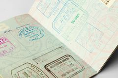 Well Traveled Passport. Closeup of an American passport with stamps from a variety of countries within the past couple of years, including England, Australia Royalty Free Stock Image