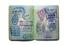 Well traveled passport. Opened passport, pages full of stamps Royalty Free Stock Photography