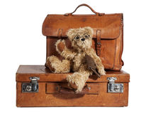 Well-Traveled Vintage Suitcase And Teddy Bear Royalty Free Stock Photos