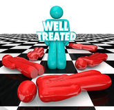 Well Treated Chess Person Standing Over People No Treatment Help. Well Treated 3d words on a person standing over other people who refused or did not receive Royalty Free Stock Photos