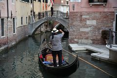 Well-uniformed condolier on a gondola, Venice Royalty Free Stock Photo