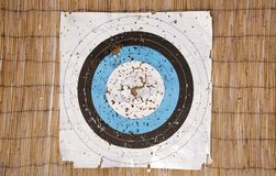A well used archery paper target with lots of holes Stock Image