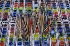 Well-used Artist Paintbrushes Arrayed Across Colorful Watercolor Pans Stock Photography