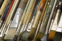 Artists brushes. Well used artists oil painting brushes close-up background Stock Image