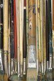 Artists brushes. Well used artists oil painting brushes close-up background Stock Photos