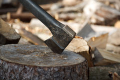 Well used axe on the stump Stock Photo