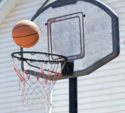Well-Used Backyard Backetball Hoop and Ball Royalty Free Stock Photos