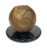 Well used baseball on granite base Royalty Free Stock Image