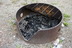 A well-used campground fire ring Stock Photo