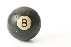 Well Used Eight-Ball. An old cracked and well used eight ball isolated on a white background Royalty Free Stock Image