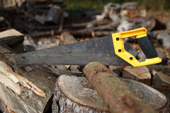 Well used hand-saw cutting wood Royalty Free Stock Images