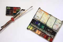 Well-used paintbox and brushes Stock Images