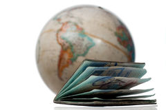A well used passport and a globe Stock Image
