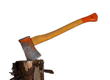 Well used rather rusty ax, axe in wood block. Stock Image