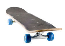 A well used skateboard, isolated Stock Images