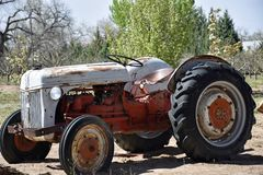 Well used Vintage Rustic Farm Tractor stock photography