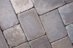 Well worn cobblestone pavers in pale tan and pink Stock Photo
