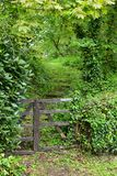 Well Worn Footpath Gate. When hiking the many footpaths in the UK, one will find gates and fences of all sorts to navigate. This one looks well used and somewhat Royalty Free Stock Photography
