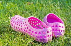 Well worn sandals left on a lawn Stock Photography