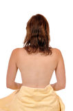 Wellbeing. Young woman with a towel on her chest in front of a white studio background Stock Photography