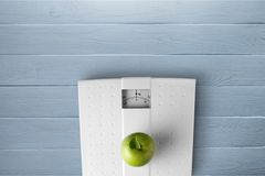 Wellbeing. Healthy lifestyle healthcare and medicine dieting exercising healthy eating apple Stock Images