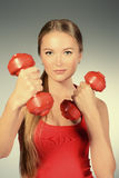 Wellbeing. Young slender woman goes in for sports. Active lifestyle Royalty Free Stock Images